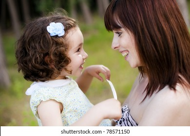 Child and mom looking and smiling each other