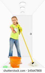 Child with mop bucket sponge in white hallway cleaning.