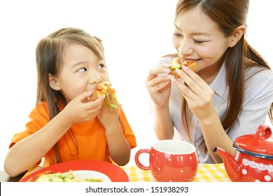 Child with mother eating foods