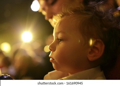 Child with mother enjoying time in the theater