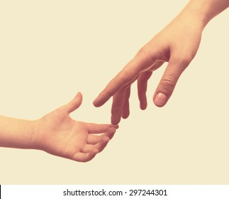 Child and mother hands on light background
