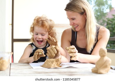 A Child and mother having fun doing creative pottery