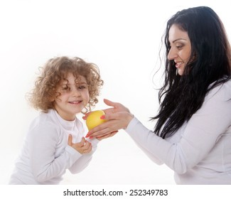 the child with mother holding apple isolated on the white background