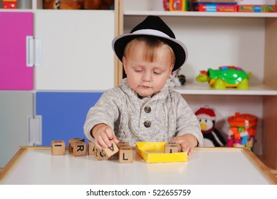 Child in a nursery built with blocks