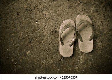 6e67cddd8ea09f child old poor sandals on dirt ground black and white style