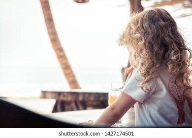 Child on beach looking into the distance sea with horizon during summer holidays vacation childhood travel lifestyle
