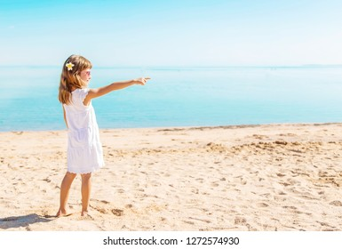 Child on the beach. Sea shore. Selective focus. nature