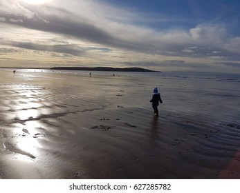 child on beach when tide is out