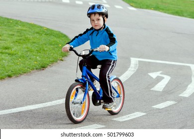 child on a bicycle at asphalt road on traffic playground