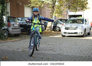 Child on a bicycle turns left