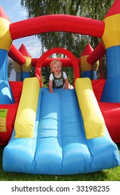 child on bouncy castle. inflatable blow-up toy for kid in garden