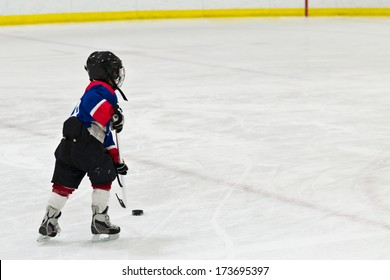Child on a breakaway during ice hockey game