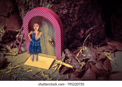 Child on doormat of door in tree. Fantasy, possibly where fairies and elves live. Is anyone home?