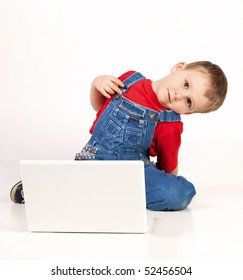 Child on the floor with laptop on white background