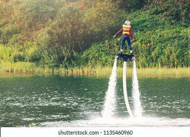 child on flyboard hover in the air