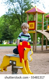 A child on outdoor playground equipment.