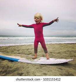 Child on surf board