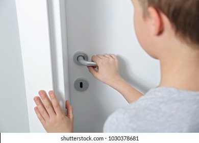 Child opening door close up. Home security, safety and privacy concept