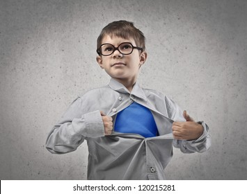 Child opening his shirt like a superhero