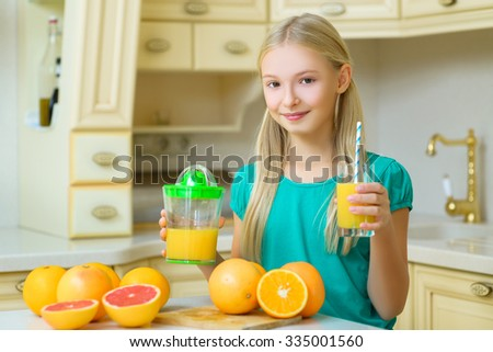 Child with oranges. Girl squeezed fresh orange juice