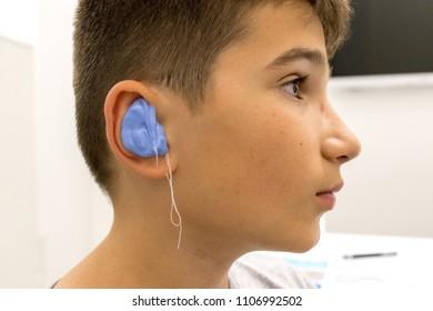 Child in the otolaryngologist's office making a custom ear plug