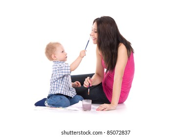 child paint on mother face isolated over white background