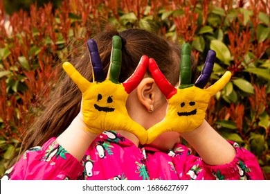 child with painted hands. selective focus