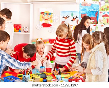 Child painting at art school. Education.