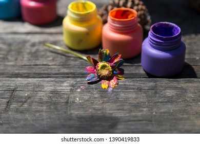 the child painting the flower with colorful finger paint for nursery,school education concept.