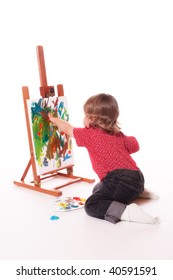 Child painting on easel with fingers