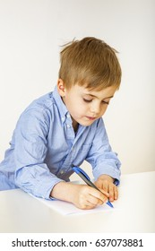 Child with paper and pen