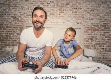 Child and parent enjoying competition