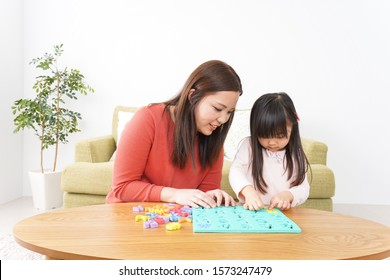 Child and parent studying at home