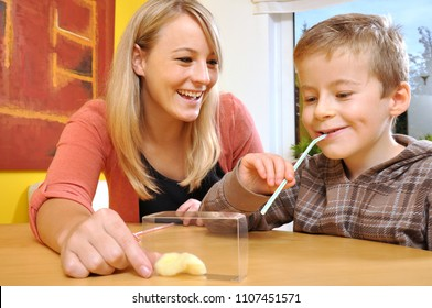 Child as a patient makes exercises with speech therapist
