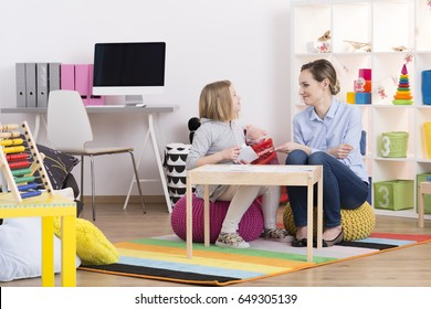 Child with pedagogue during the session of play therapy