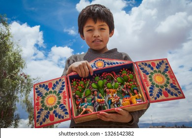 Child from the Peruvian Andes shows us an altarpiece. February 2014, Ayacucho Peru
