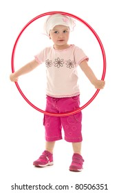 Child plaies with hula hoop,on white background.
