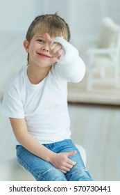 A child with a plaster on his hand