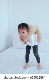 Child play on bed, little girl screaming and fun