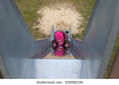 child at the playground sliding backwards the childrens slider