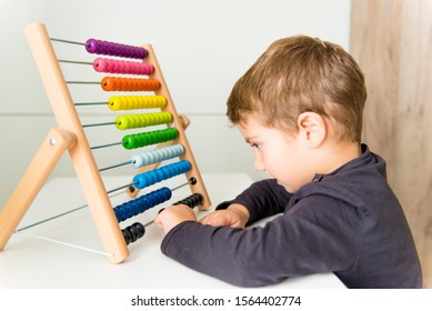 The child playing with abacus at home.