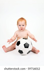 The child playing with a ball on a white background