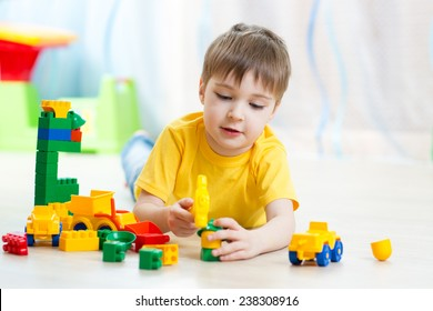 child playing with block toys at home or kindergarten