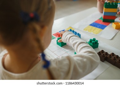 Child playing with blocks educational kit in the kindergarten