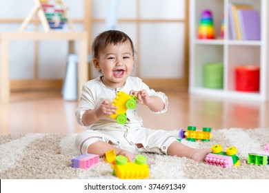 Child playing with building blocks at home