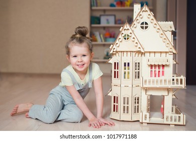 child playing and building wooden house