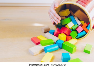 child playing with colorful wooden blocks - shallow depth of field