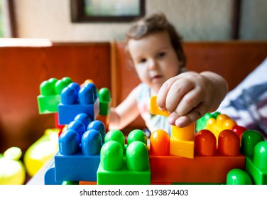 Child playing with cubes. Puts a cube