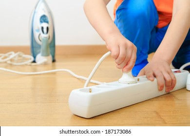 child playing with electricity, kids safety concept