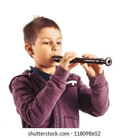 Child playing flute, isolated on white background.
